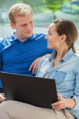 Happy couple using internet at home — Stock Photo