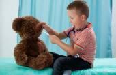 Preschooler and his teddy bear — Stock Photo