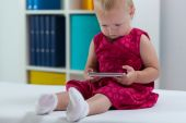 Baby playing mobile phone — Stock Photo