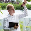 Garden expert checking beetroot condition — Stock Photo #54192921
