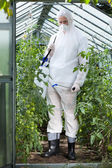 Garden worker in protective clothing — Stock Photo