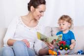 Mother reading book of her son — Stock Photo
