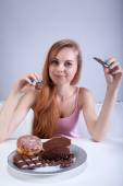 Girl eating sweets — Stock Photo