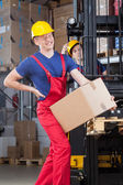 Man with a backache in factory — Foto Stock
