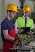 Supervision in a factory — Stock Photo