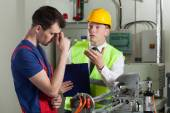 Worker made a mistake in a factory — Stock Photo
