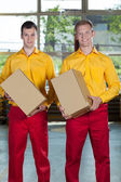 Factory workers with boxes — Stock Photo