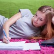 Teenage girl doing homework — Stock Photo #55004779