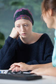 Woeful woman suffering from cancer — Stock Photo