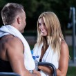Attractive woman talking with athletic man — Stock Photo #55013171