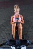 Smiling girl exercising on incline bench — Stock Photo
