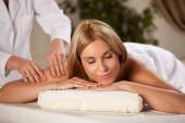 Woman relaxing during pleasant massage — Stock Photo