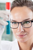 Lab technician holding tube — Stock Photo