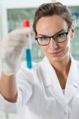 Lab technician analyzing result of experiment — Stock Photo