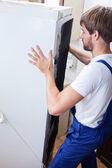 Fixing fridge at home — Stock Photo