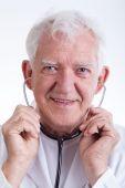 Senior physician with stethoscope — Stockfoto