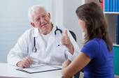 General practitioner showing thumb up — Stock Photo