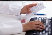Pharmacist checking information about medicines — Stock Photo