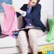 Woman working and folding clothes — Stock Photo #56099987