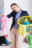 Businesswoman holding a laundry basket — Stock Photo