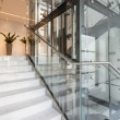Glass elevator in modern building — Stockfoto #56280679