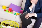 Man in suit sitting on sofa — Stock Photo