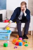 Elegant man cleaning up toys — Stock Photo