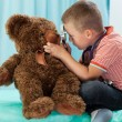 Little boy playing on doctor — Stock Photo #56389493