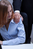 Woman doesn't like boss's touch — Stock Photo