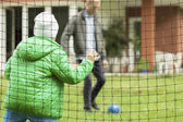 Father and son playing football together — Stockfoto