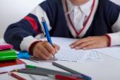 Schoolboy doing wordsearch — Stock Photo