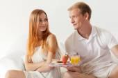 Men brings breakfast — Stock Photo