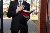 Jehovah's witness standing at the door — Stock Photo