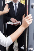 Talking Jehovah's witness to leave her house — Stock Photo