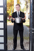 Canvasser selling stainless pot — Stock Photo
