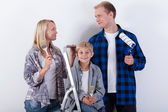 Happy family renovating their new home — Stock Photo