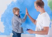 Young father giving high five to his little son — Stock Photo