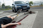 Casualty in blood on the road — Stock Photo