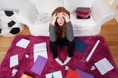Girl, a room, books and notes for school — Stock Photo