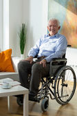Man on wheelchair — Stock Photo