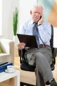 Elderly businessman — Stock Photo