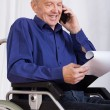 Disabled man talking on phone — Stock Photo #58161997