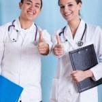 Diverse doctors showing okay gesture — Stock Photo #58163723