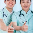 Couple of doctors with okay gesture — Stock Photo #58164213