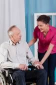 Disabled man on wheelchair and nurse — Stock Photo