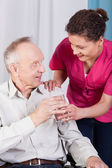 Disabled man drinking water — Stock Photo