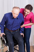 Nurse helping disabled patient — Stock Photo