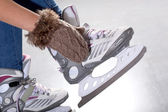 Putting on ice skates — Stock Photo