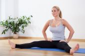 Woman stretching her body — Stock Photo