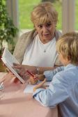 Grandma teaching his grandson — Stock Photo